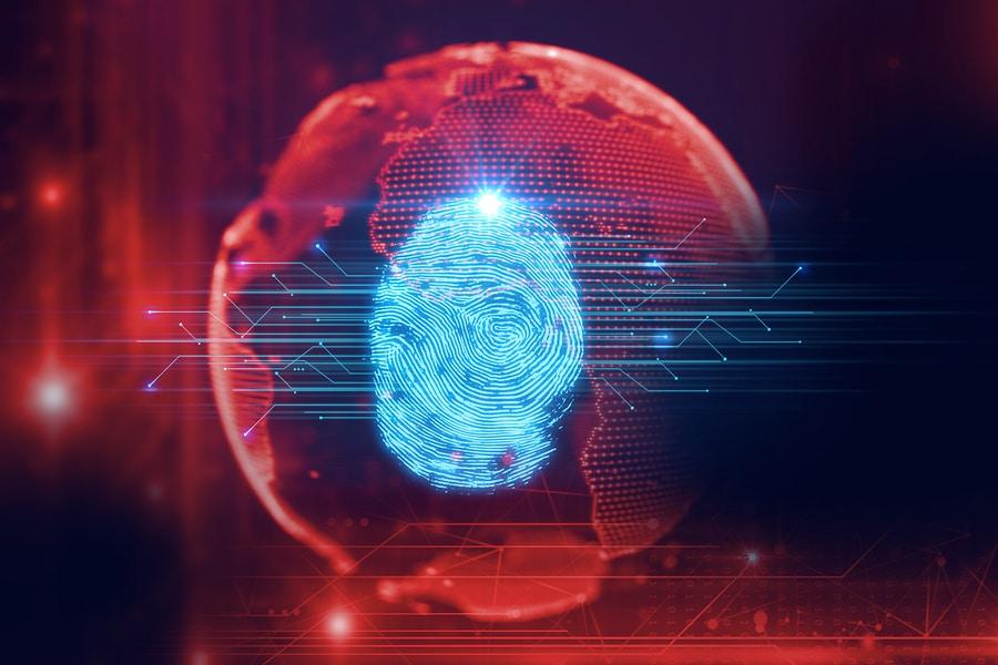 Fingerabdruck auf einer Weltkugel, im Hintergrund einige technische Linien