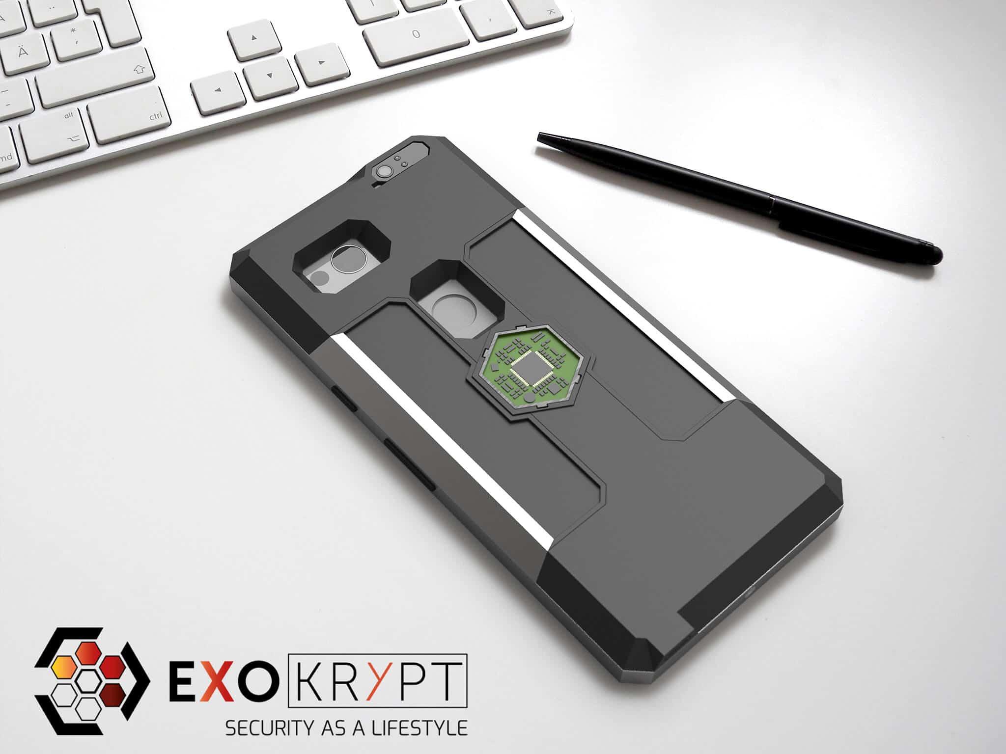 ExoShield BUSINESS Smartphone Case - Brushed Metal Frame - Schwarze Inlets auf einem Tisch auf einem Papierblatt liegend mit Kugelschreiber daneben, Mac Tastatur darüber
