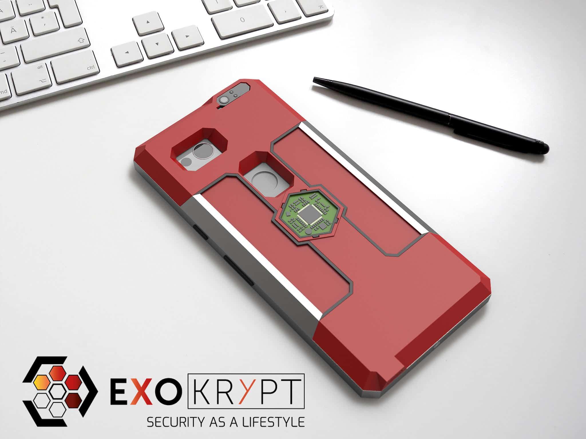 ExoShield BUSINESS Smartphone Case - Brushed Metal Frame - Rote Inlets - Rotes Case auf einem Tisch auf einem Papierblatt liegend mit Kugelschreiber daneben, Mac Tastatur darüber