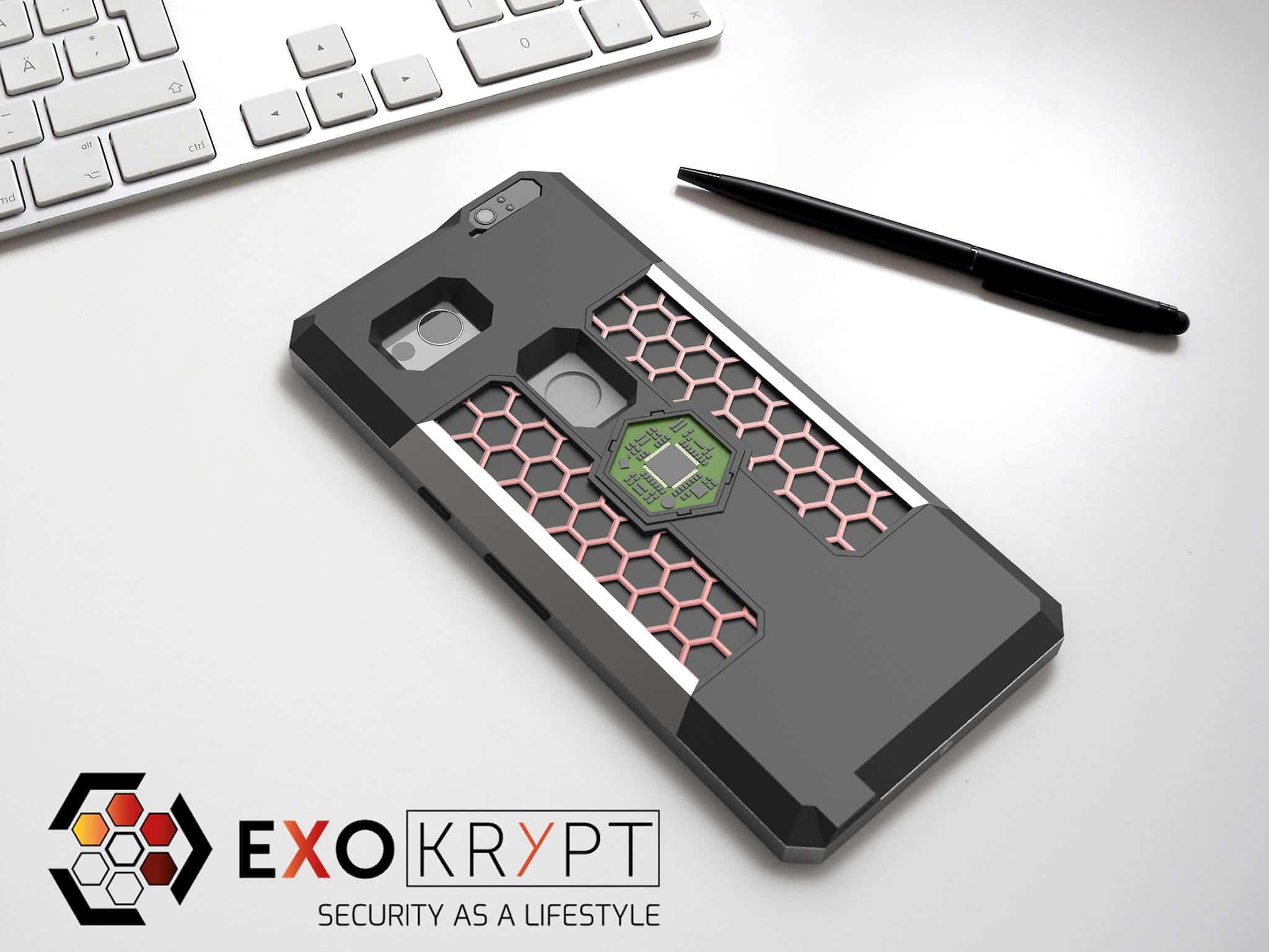 ExoShield BUSINESS Smartphone Case - Brushed Metal Frame - Red Hexagon Inlets auf einem Tisch auf einem Papierblatt liegend mit Kugelschreiber daneben, Mac Tastatur darüber