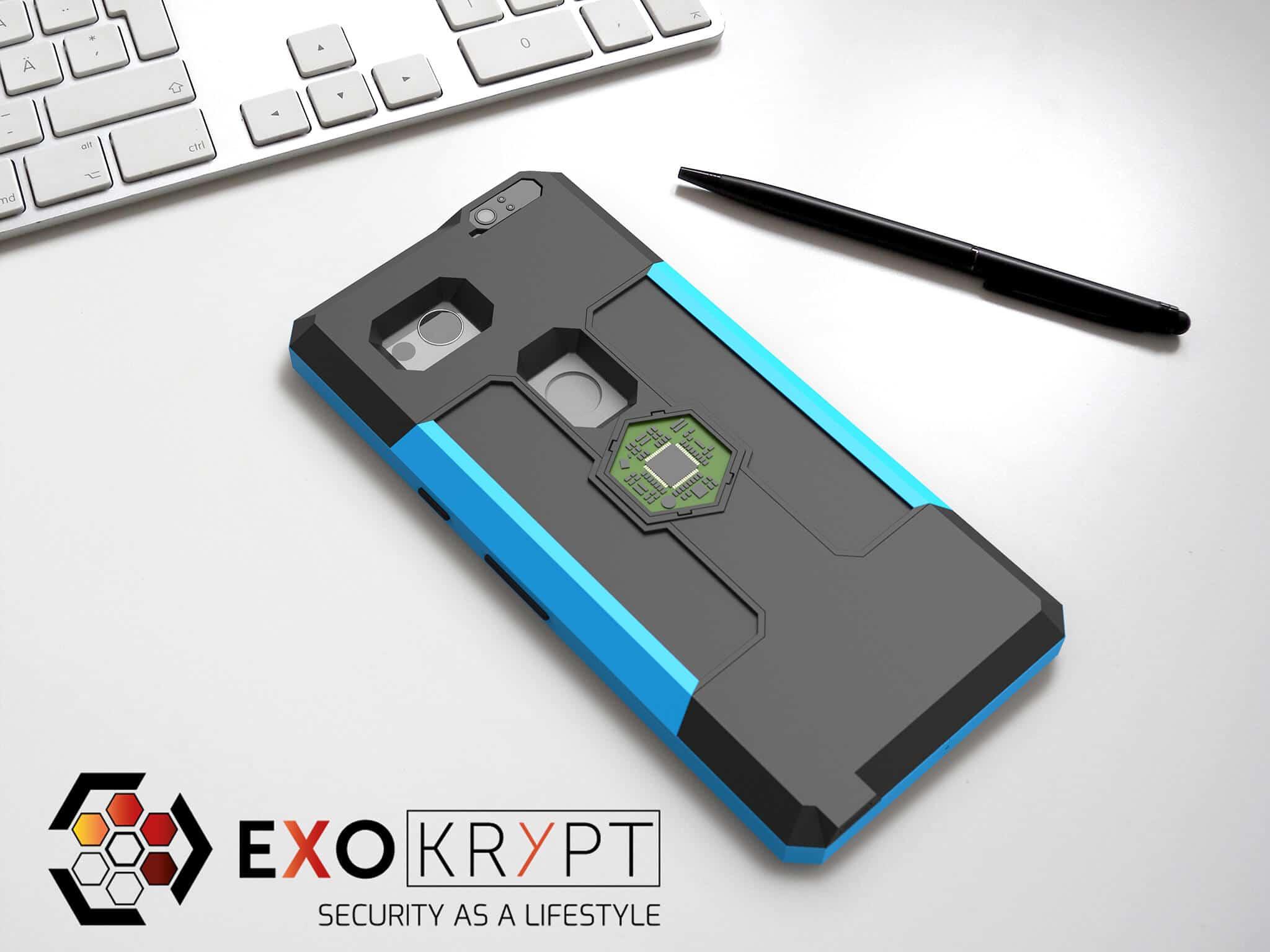 ExoShield BUSINESS Smartphone Case - Brushed Turkis Metal Frame - Dark Black Inlets auf einem Tisch auf einem Papierblatt liegend mit Kugelschreiber daneben, Mac Tastatur darüber