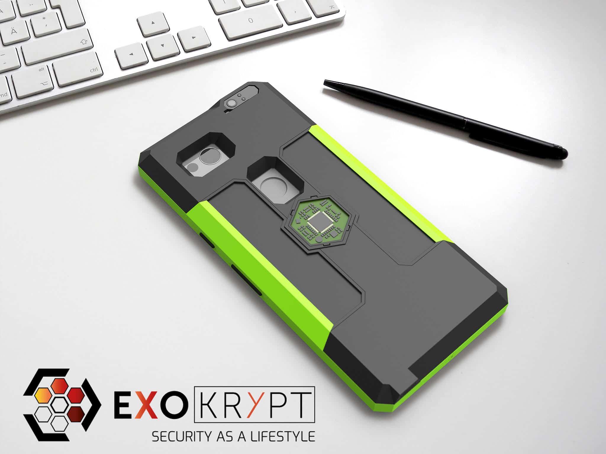 ExoShield BUSINESS Smartphone Case - Brushed Toxic Green Metal Frame - Dark Black Inlets auf einem Tisch auf einem Papierblatt liegend mit Kugelschreiber daneben, Mac Tastatur darüber