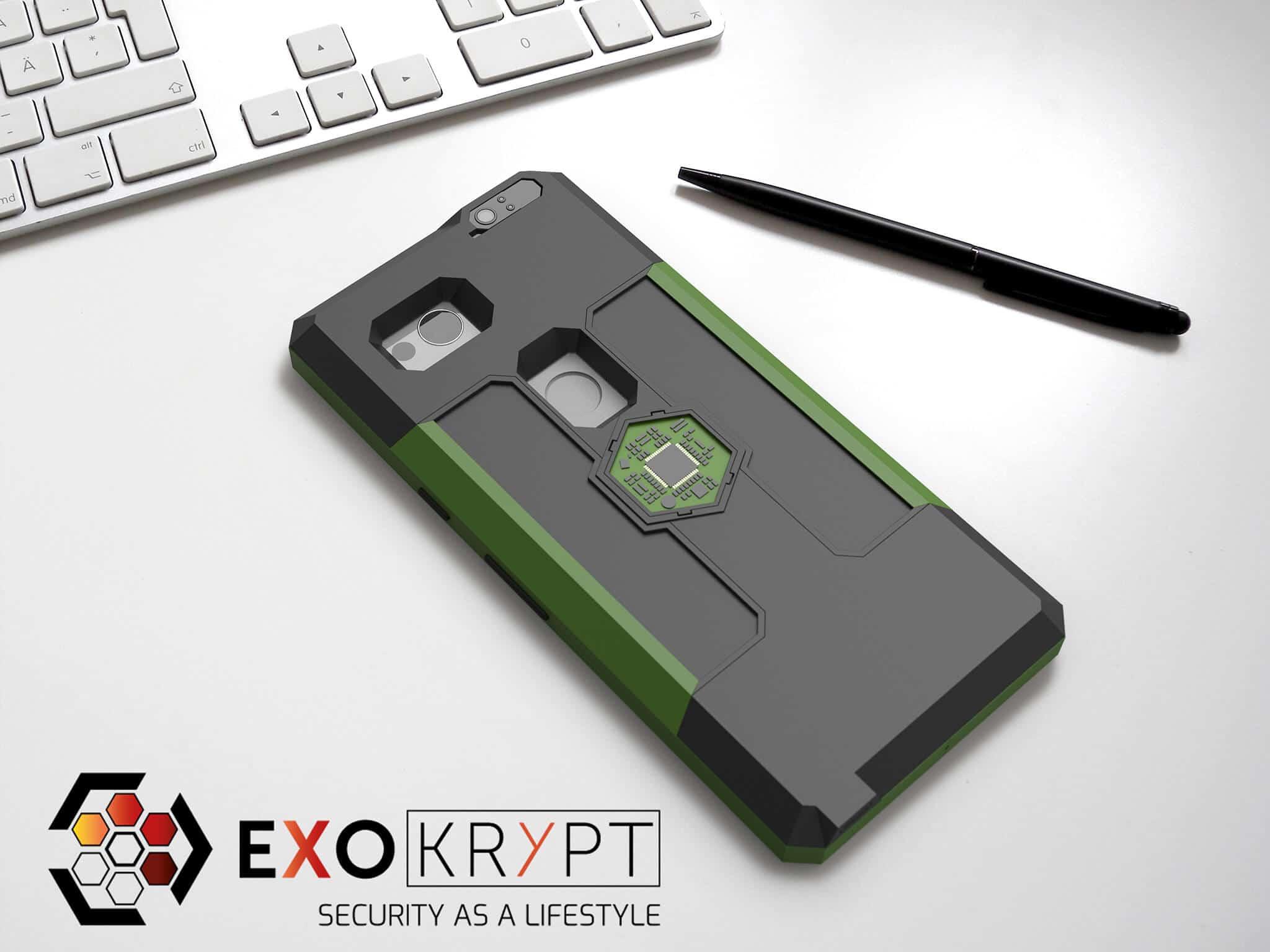 ExoShield BUSINESS Smartphone Case - Brushed Olive Metal Frame - Schwarze Inlets auf einem Tisch auf einem Papierblatt liegend mit Kugelschreiber daneben, Mac Tastatur darüber