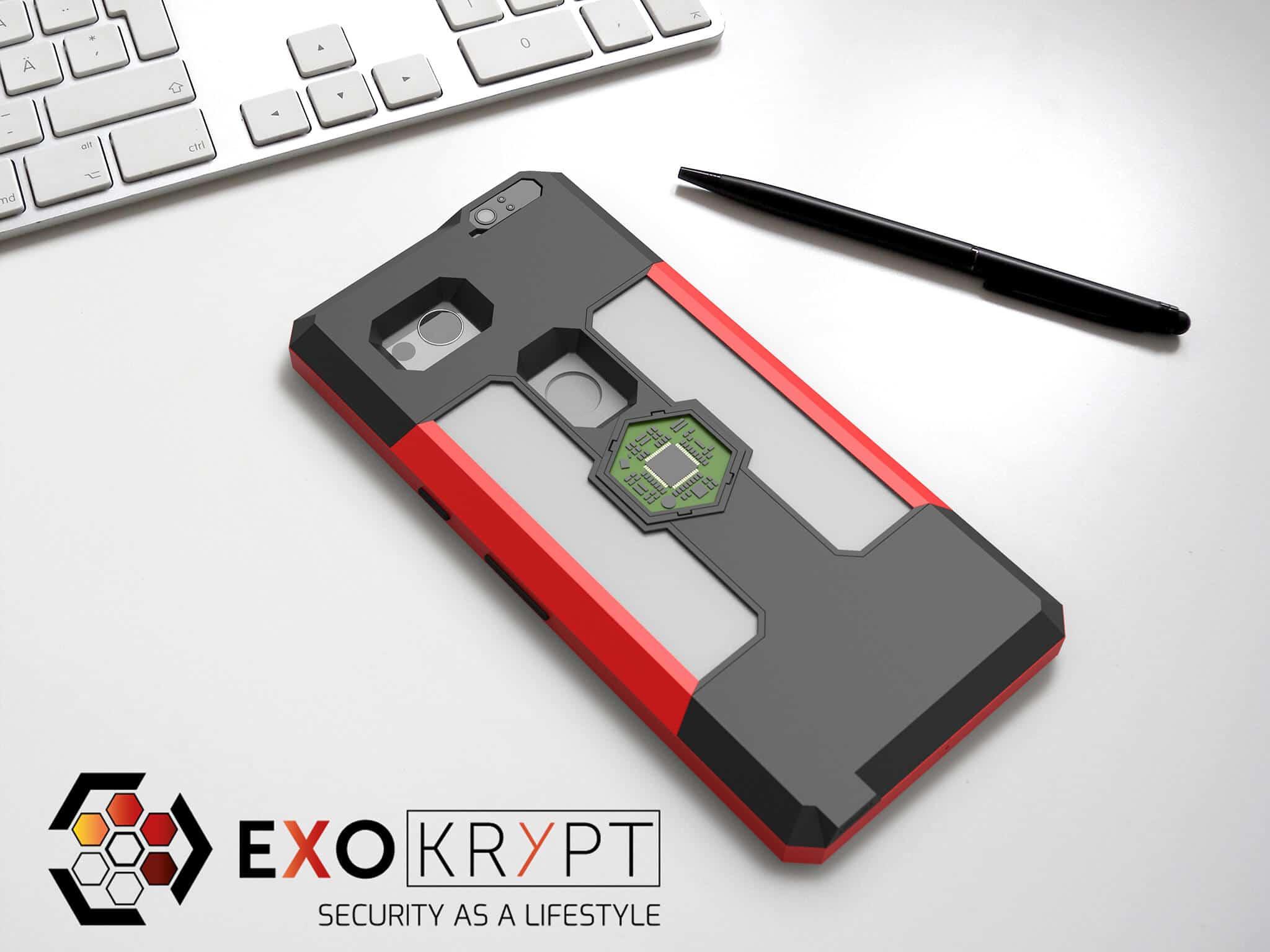 ExoShield BUSINESS Smartphone Case - Brushed Red Metal Frame - Graue Inlets auf einem Tisch auf einem Papierblatt liegend mit Kugelschreiber daneben, Mac Tastatur darüber