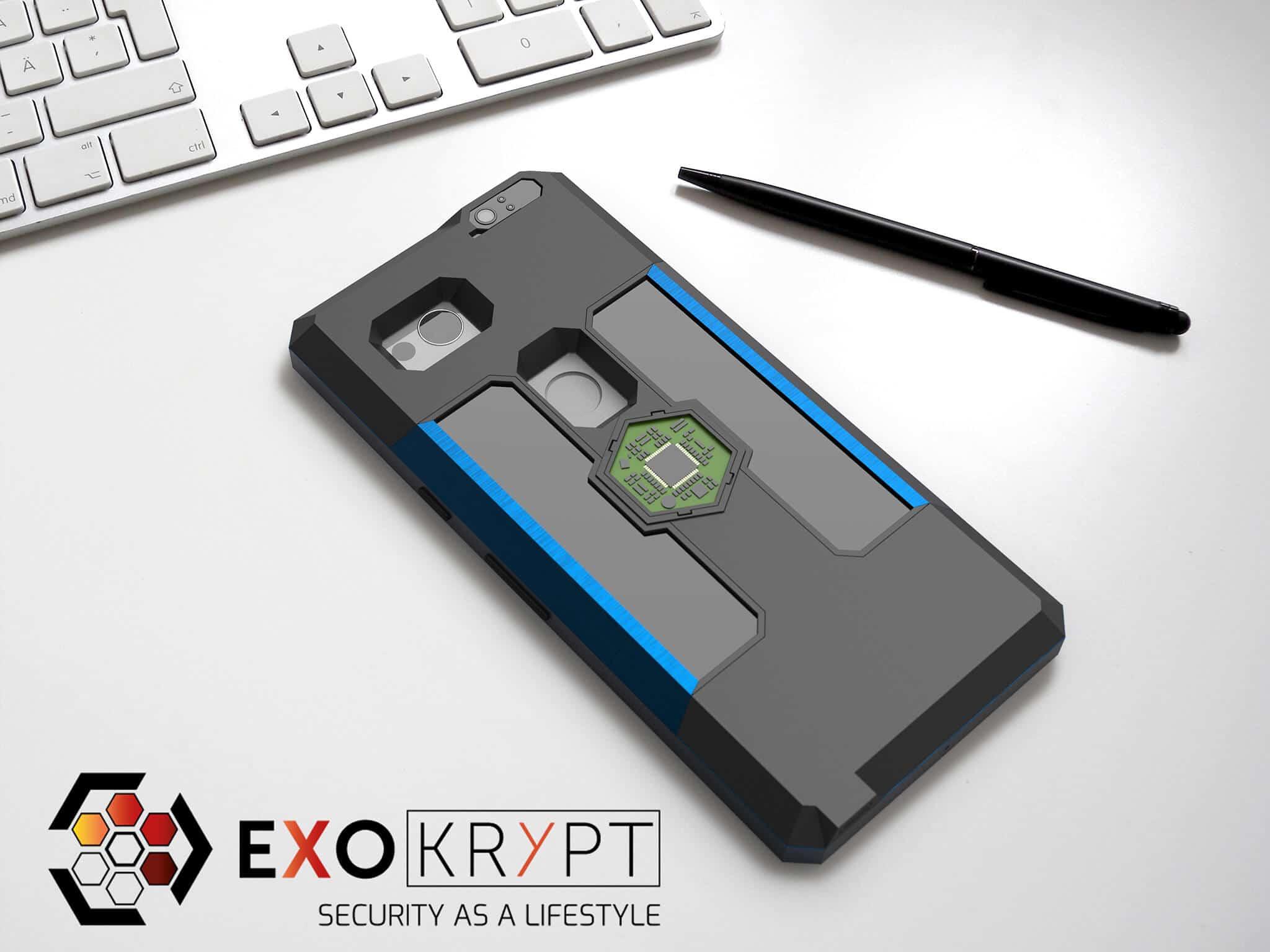 ExoShield BUSINESS Smartphone Case - Brushed Blue Metal Frame - Schwarze Inlets auf einem Tisch auf einem Papierblatt liegend mit Kugelschreiber daneben, Mac Tastatur darüber