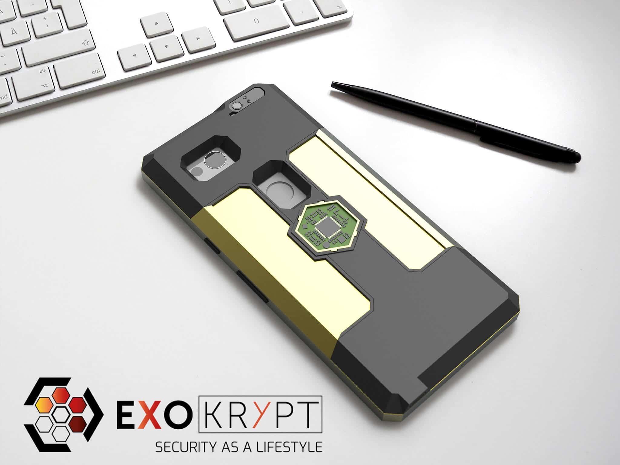ExoShield BUSINESS Smartphone Case - Brushed Gold Frame - Gold Inlets auf einem Tisch auf einem Papierblatt liegend mit Kugelschreiber daneben, Mac Tastatur darüber