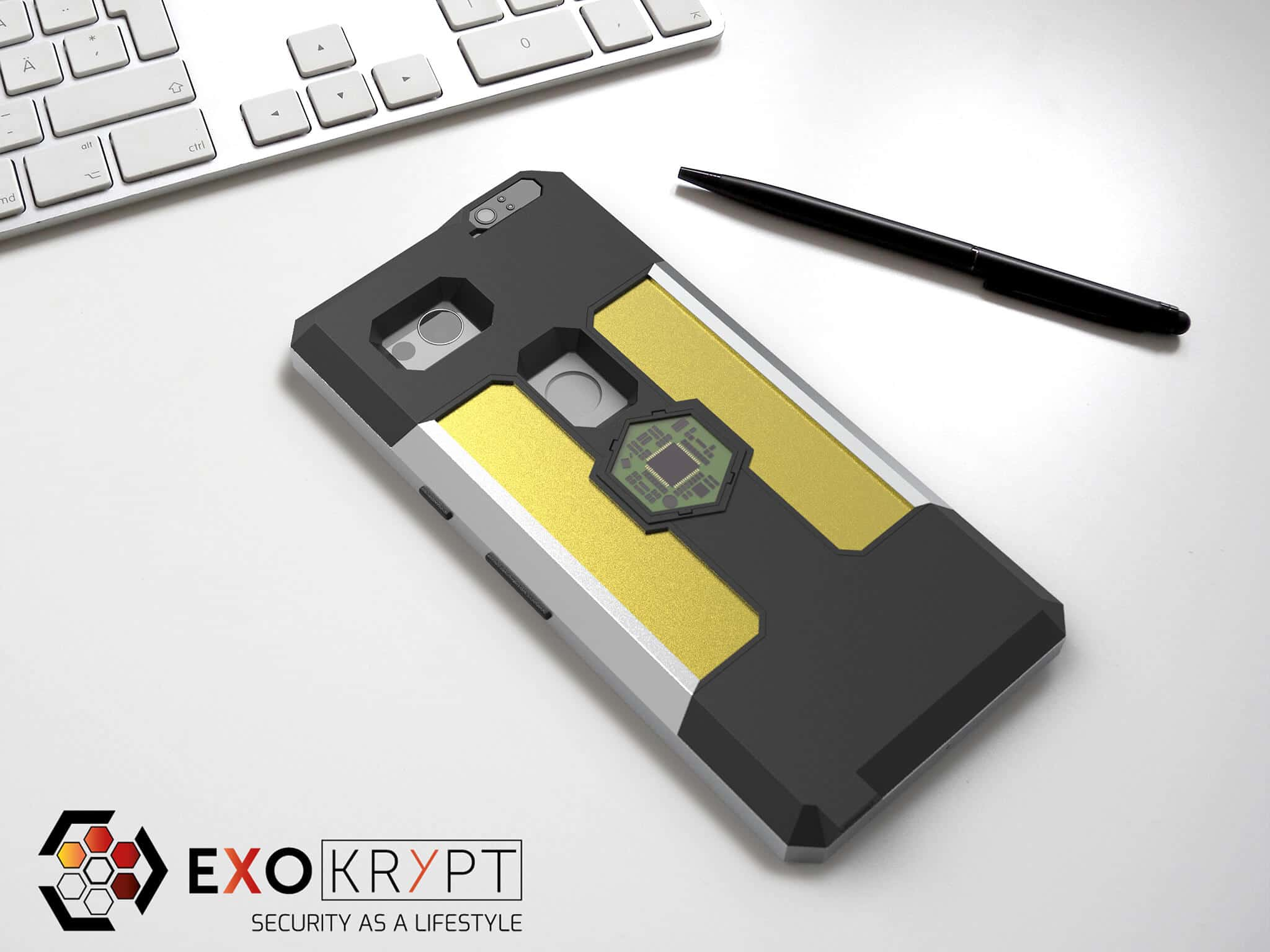 ExoShield BUSINESS Smartphone Case - Brushed Metal Frame - Gold Inlets auf einem Tisch auf einem Papierblatt liegend mit Kugelschreiber daneben, Mac Tastatur darüber